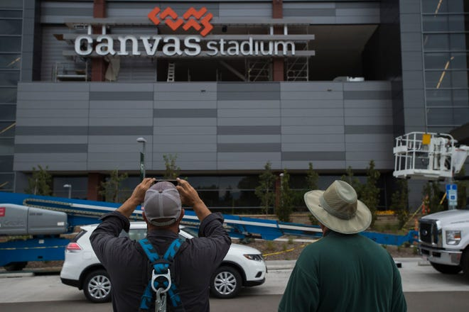 DaVinci Sign Systems, Inc. lead installer Will Strickland, left, and project manager Jerry Zito look onto the newly installed West-facing Canvas Stadium logo sign on Colorado State University's football stadium on Tuesday, Aug. 21, 2018, in Fort Collins, Colo.