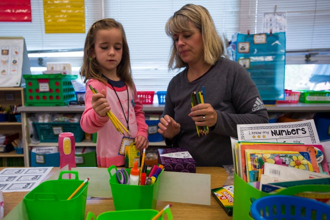 Gracie Foster, 6, and her mother Sarah organize Gracie's school supplies during her first day of kindergarten in Kelly Hancock's class on Tuesday, Aug. 21, 2018, at Cache La Poudre Elementary School in Laporte, Colo.