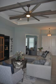 Cypress beams stained and weathered gray form the family room ceiling.