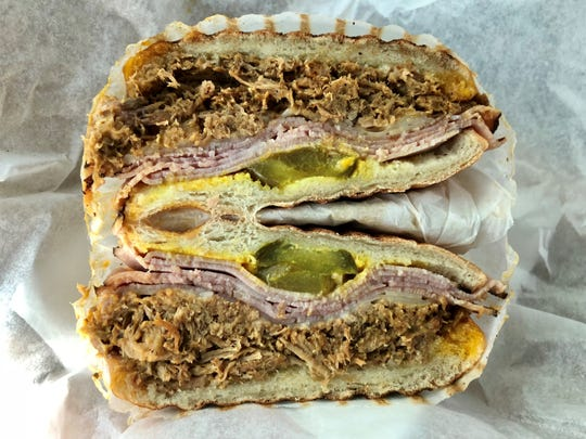 The Gathering Place crafts its Cuban sandwich with a thick layer of pulled pork.