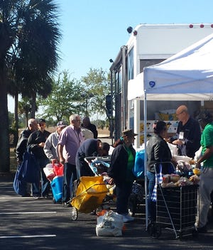 This photo from March of this year shows a Harry Chapin Food Bank mobile pantry in action at Iglesia Cristiana Misionera in Lehigh Acres.