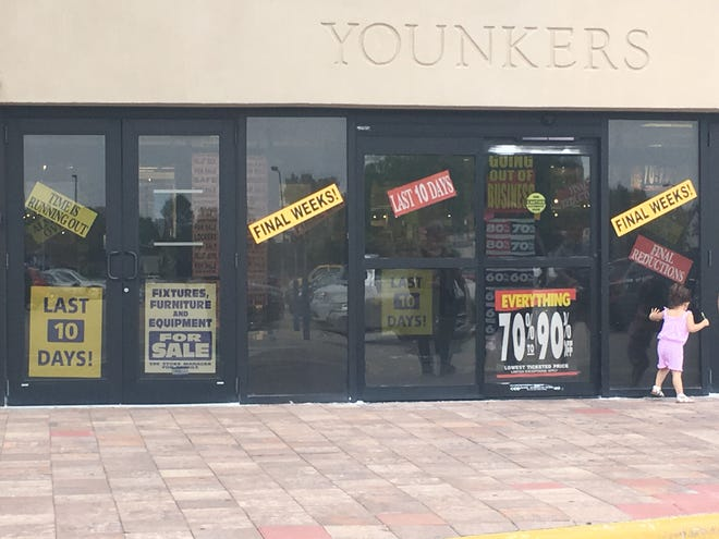 Signs on the former Younkers store in Bay Park Square announced the final clearance in advance of the store's last day on Aug. 30.