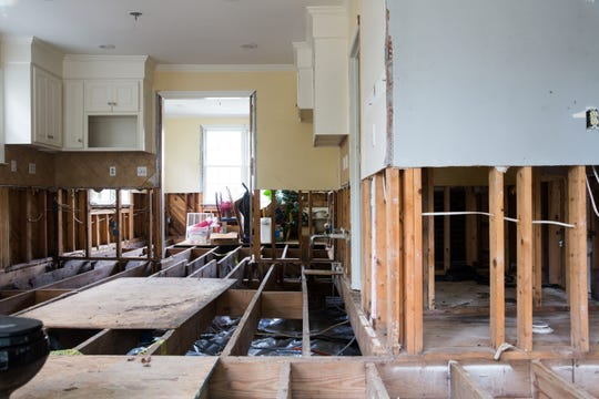 Elizabeth Boineau's Charleston, S.C., home, above and below, was damaged by flooding, leading to big repairs. Now that she's demolishing the home, she says, whoever buys her property can build an elevated home on it.