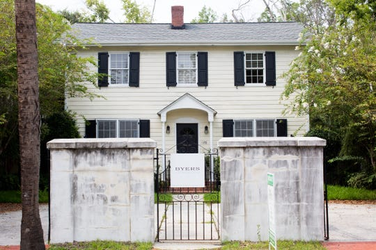 Elizabeth Boineau decided to demolish her home in Charleston, S.C., shown above, and sell the lot after the two-story Colonial was damaged by flooding.