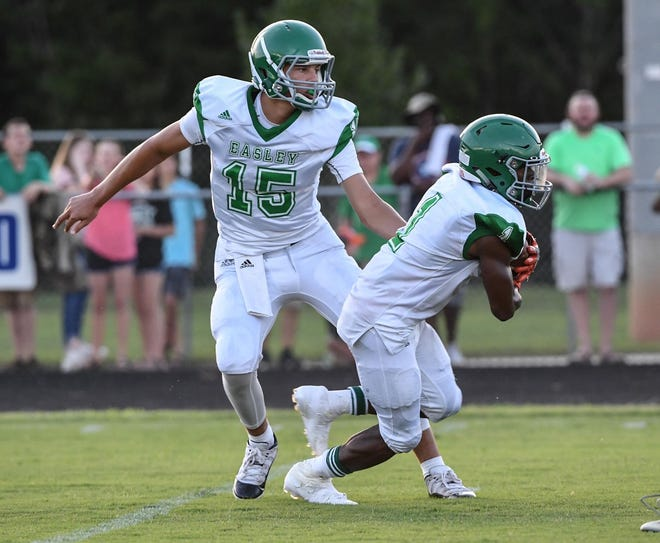 Easley running back Jeremy Harried, right, rushed for 145 yards in the Green Wave's 13-7 win over Pickens in Week 0.