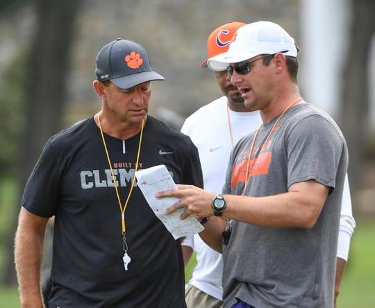 Clemson Head Coach Dabo Swinney, left, Clemson co-offensive coordinators Tony Elliott, and Jefff Scott, during practice at Clemson University on Tuesday, August 21.