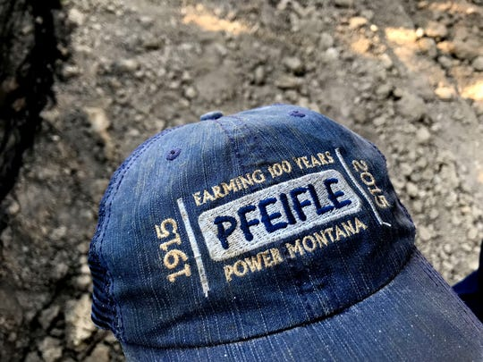 The Pfeifle family commemorated the centennial of the founding of their farm in Power with custom hats.