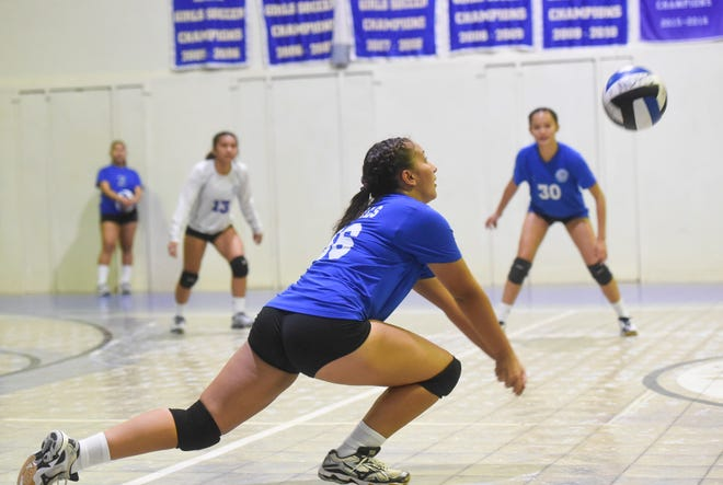 In this Aug. 21 file photo, Notre Dame's Gabrielle Piper anticipates the ball during an IIAAG High School Girl's Volleyball match.