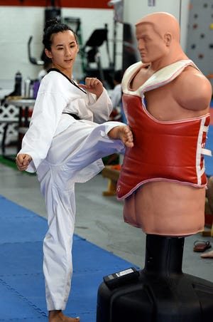 Stephanie Keenan, a 2008 Oceania Taekwondo Championships silver medalist, is shown practicing the roundhouse on a Bob XL punching bag, equipped with an instrument to measure the strength and speed of the kick. A power kicking tournament will featured at the 2018 Master Noly's Super Taekwondo Tournament Aug. 26 at the Micronesia Mall.