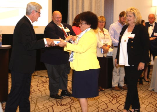 Pine Belt judges Deborah Gambrell, left, and Richelle Lumpkin receive recognition from Gov. Phil Bryant