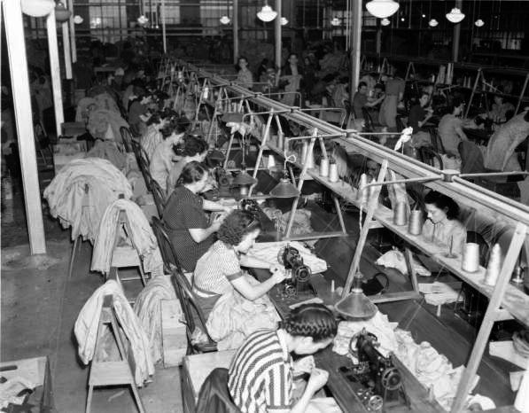 CBS Dress Factory employees hard at work creating women's clothing.