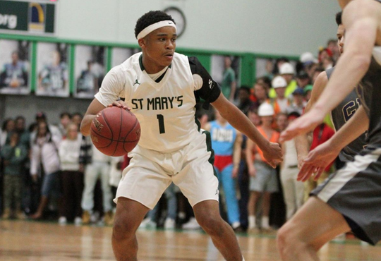 Iowa 2019 point guard target dribbles during a game with St. Mary's in St. Louis.