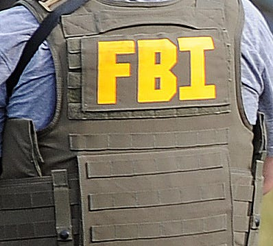 An agent with the Federal Bureau of Investigations is shown with his protective vest.