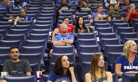 An Indianapolis Colts fans attempts to stay awake late in the second half of their preseason football game at Lucas Oil Stadium on MondayAug 20.