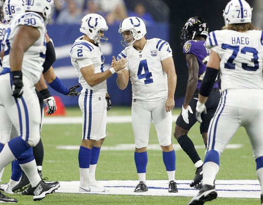 Indianapolis Colts kicker Adam Vinatieri (4) celebrates his 57-yard field goal with Rigoberto Sanchez (2) in the first half of their preseason football game at Lucas Oil Stadium on MondayAug 20.