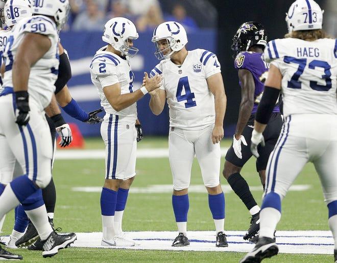 Indianapolis Colts kicker Adam Vinatieri (4) celebrates his 57-yard field goal with Rigoberto Sanchez (2) in the first half of their preseason football game at Lucas Oil Stadium on MondayAug 20.