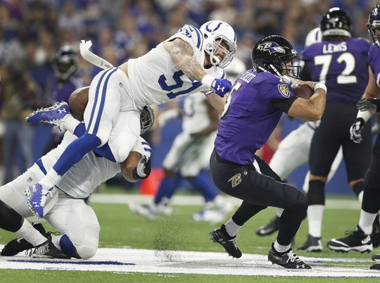 Indianapolis Colts defensive end John Simon (51) flies in the air to sack Baltimore Ravens quarterback Joe Flacco (5) in the first half of their preseason football game at Lucas Oil Stadium on MondayAug 20.