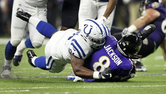 Indianapolis Colts defensive tackle Hassan Ridgeway (91) sacks Baltimore Ravens quarterback Lamar Jackson (8) in the first half of their preseason football game at Lucas Oil Stadium on MondayAug 20.