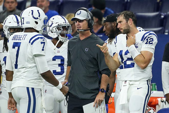 From left, Indianapolis Colts quarterback Jacoby Brissett (7) prepares to enter the game as head coach Frank Reich and quarterback Andrew Luck (12) talk to him from the sideline, in the first half of their preseason game against the Baltimore Ravens at Lucas Oil Stadium in Indianapolis, Monday, Aug. 20, 2018.