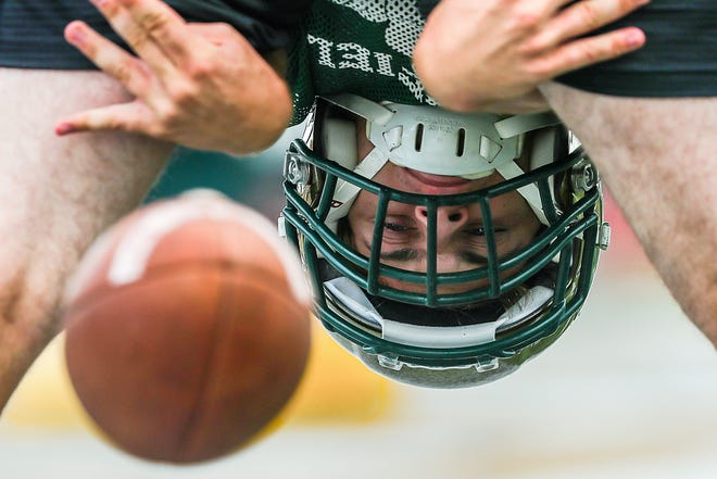 Westfield Rocks long-snapper Sam Lupear snaps the football during practice at Westfield High School in Westfield, Ind., Tuesday, Aug. 21, 2018.
