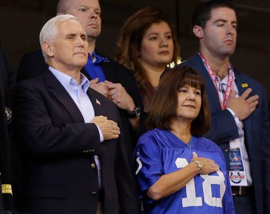 Vice President Mike Pence and his wife, Karen, stood during the playing of the national anthem before an NFL football game between the Indianapolis Colts and the San Francisco 49ers on Oct. 8, 2017.  Pence left the game after some players knelt during the anthem. (AP Photo/Michael Conroy)