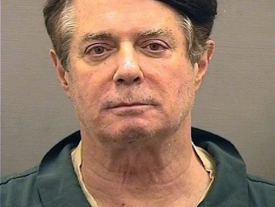 Paul Manafort poses for a mugshot at the Alexandria Detention Center in Alexandria, Virginia.