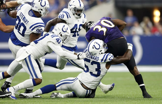 Indianapolis Colts linebacker Darius Leonard (53) tackled Baltimore Ravens running back Kenneth Dixon (30) in the first half of their preseason football game at Lucas Oil Stadium on MondayAug 20.