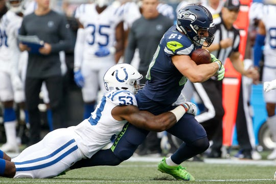 Seattle Seahawks tight end Nick Vannett (81) is tackled by Indianapolis Colts linebacker Darius Leonard (53) after making a reception during the first quarter at CenturyLink Field.