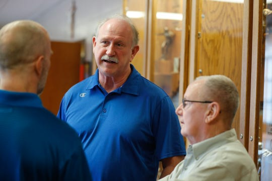 Former Roncalli High School Football Coaches, Bruce Scifres, center, and Bob Tully, right, are interviewed by IndyStar Columnist Gregg Doyel at Roncalli H.S. in Indianapolis on Tuesday, Aug. 21, 2018. The two will be inducted together into the Indiana Football Hall of Fame.