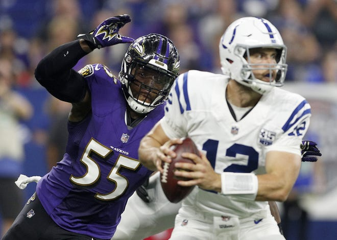 Baltimore Ravens linebacker Terrell Suggs (55) eyes Indianapolis Colts quarterback Andrew Luck (12) for a sack in the first half of their preseason football game at Lucas Oil Stadium on MondayAug 20.