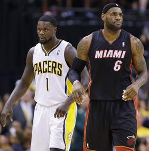 Indiana Pacers guard Lance Stephenson (1) and Miami Heat forward LeBron James (6) head along the court between plays during the second half of Game 5 of the NBA basketball Eastern Conference finals in Indianapolis, Wednesday, May 28, 2014. Indiana won 90-93. (AP Photo/Michael Conroy)