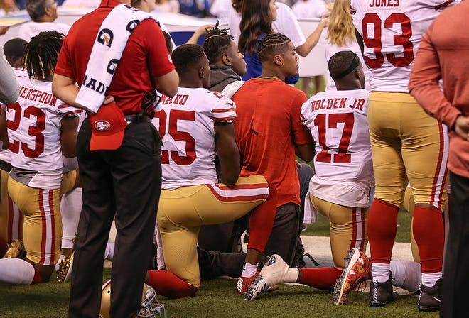 Some San Francisco 49ers knelt during the National Anthem before their game against the Indianapolis Colts on Oct. 8, 201, at Lucas Oil Stadium. The 49ers return to Indianapolis Aug. 25.