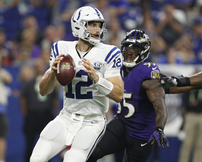 Indianapolis Colts quarterback Andrew Luck (12) drops back to pass in the first half of their preseason football game at Lucas Oil Stadium on MondayAug 20.