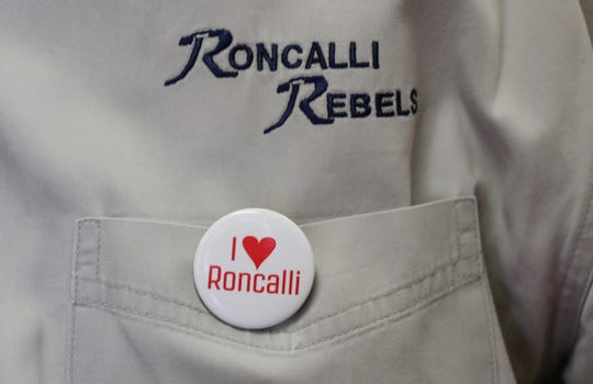 """Former Roncalli High School Football Coach, Bob Tully, wears a """"I Love Roncalli"""" pin while he and fellow former R.H.S. Football Coach Bruce Scifres are interviewed by IndyStar Columnist Gregg Doyel at Roncalli H.S. in Indianapolis on Tuesday, Aug. 21, 2018. The two will be inducted together into the Indiana Football Hall of Fame."""