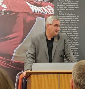 Gov. Eric Holcomb at a news conference Tuesday at NCAA headquarters announcing a partnership designed to promote innovation in sports technology in Indianapolis.