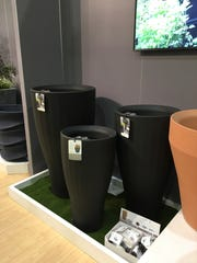 Crescent Garden specializes in lightweight, self-watering planters in dozens of shapes and size and for many types of uses, indoors and out.