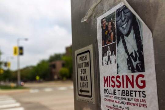 Flyers for missing University of Iowa student Mollie Tibbetts are seen along Madison Avenue on Tuesday, Aug. 21, 2018, on the University of Iowa campus in Iowa City. Tibbetts was last seen jogging July 18 in Brooklyn, Iowa.