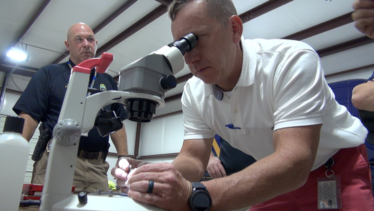 A Tupelo Police Department detective learns how to assess the marks on shell casings before entering them into NIBIN.