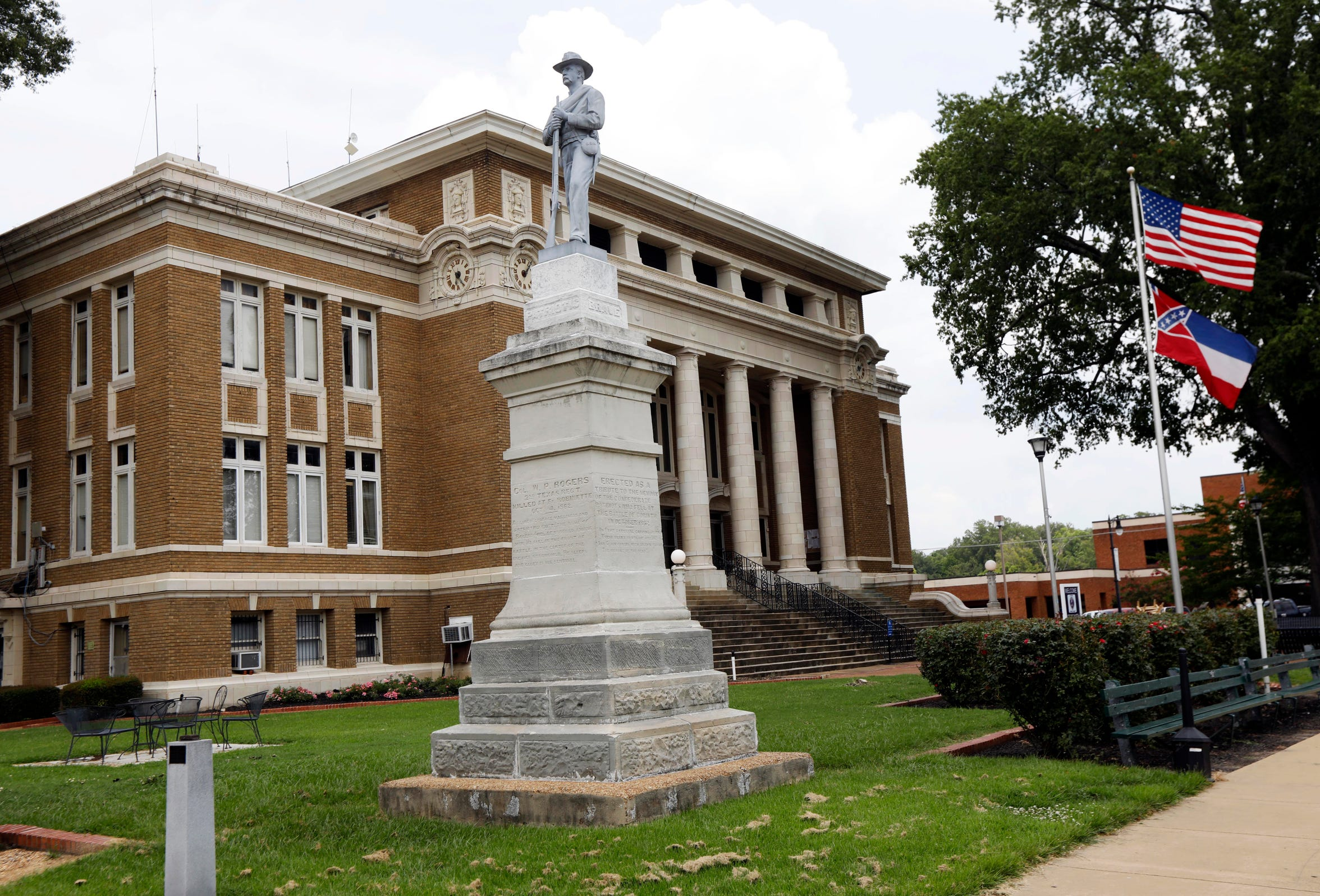 In this July 30, 2018 photo, a statue honoring the Confederate soldiers who fell at the battle of Corinth in 1862 stands outside a courthouse in the Corinth, Miss., town square. Inside the courthouse, old handwritten records show that on Jan. 26, 1960, Jerry Darnell Glidewell pleaded guilty to manslaughter.