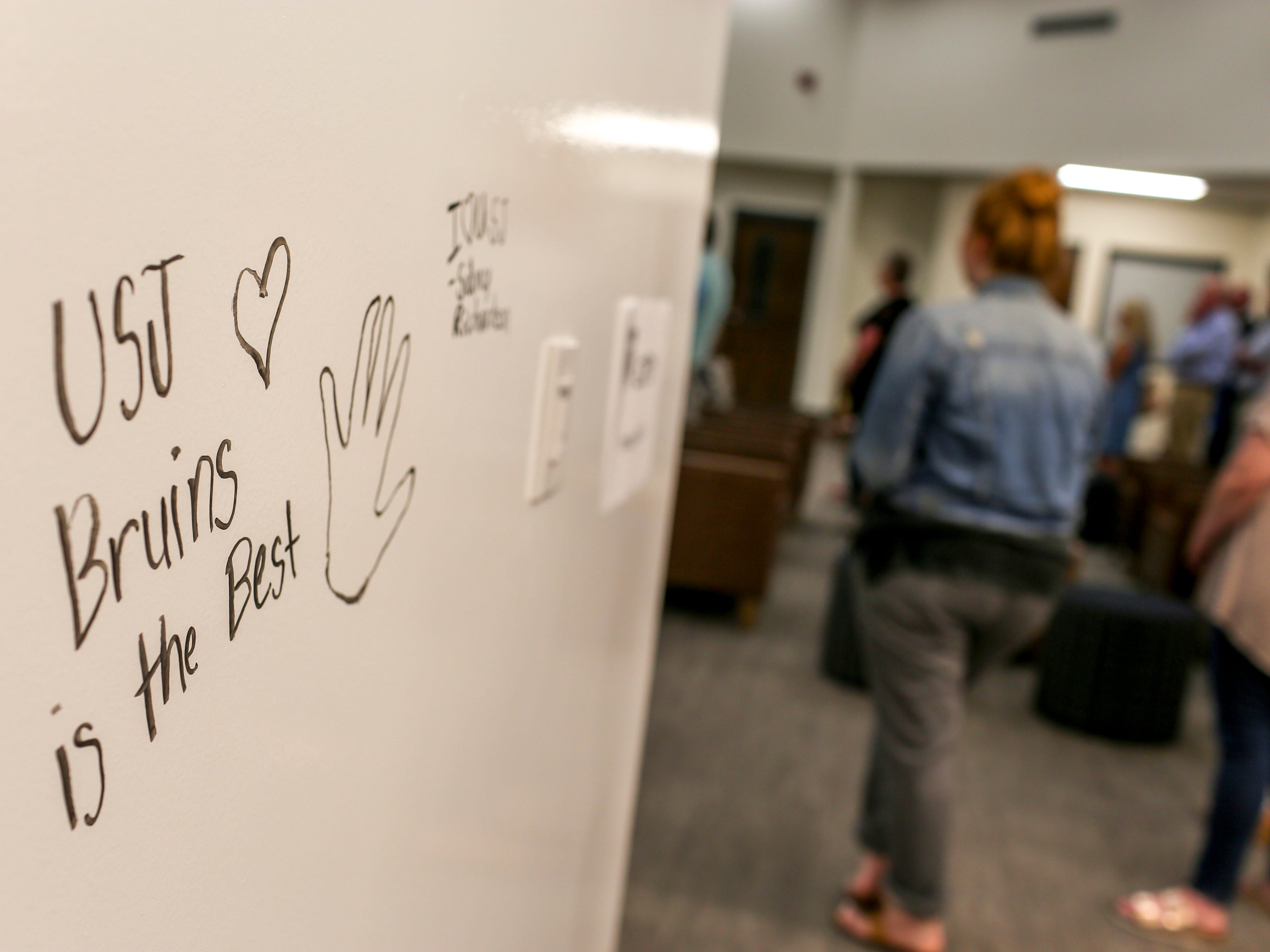 Writing on the wall borders the area where a new library is announced at University School of Jackson in Jackson, Tenn., on Monday, Aug. 20, 2018.
