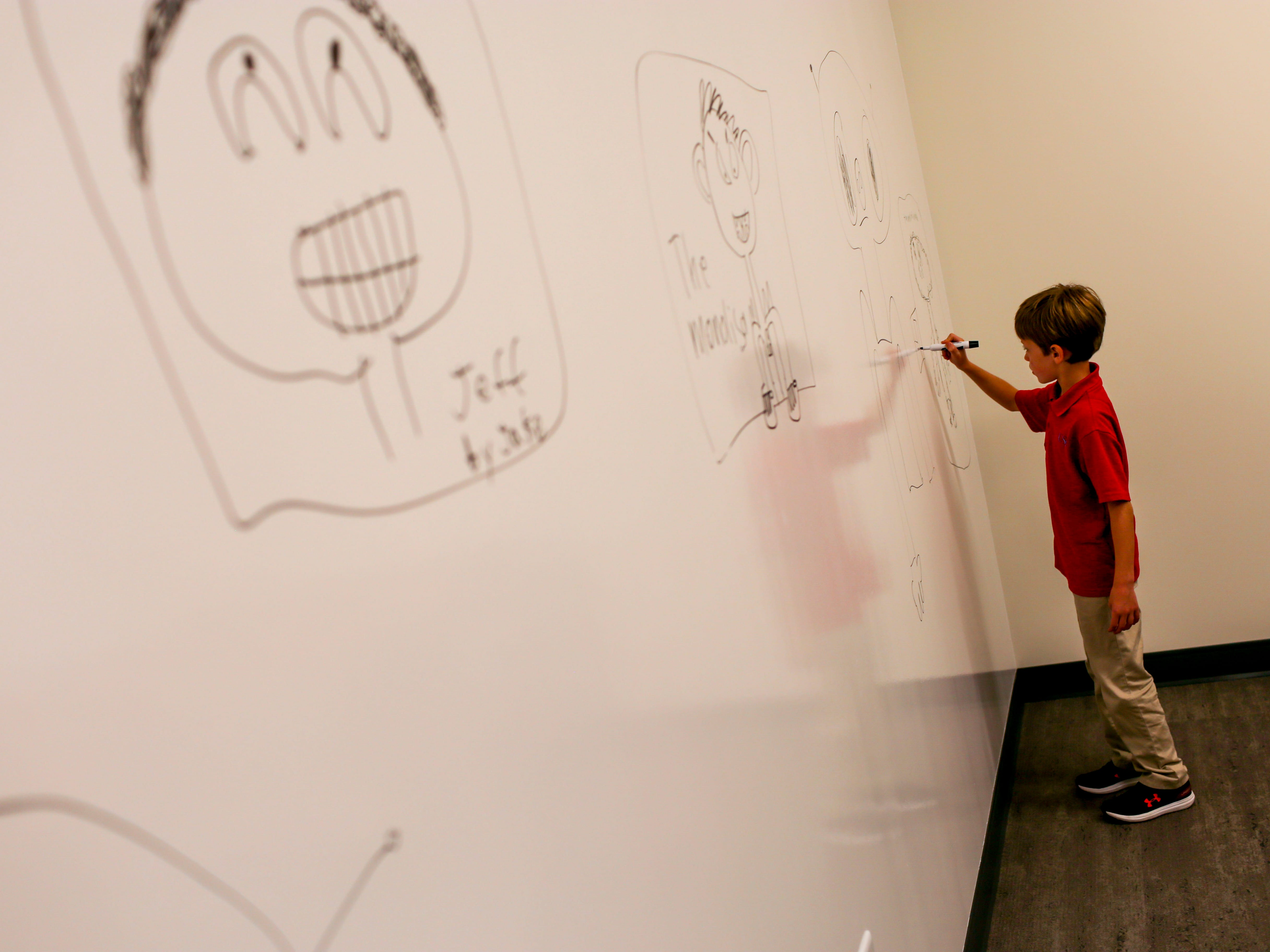 Landon McCord, 8, adds details to his drawing of an alien one a wall at University School of Jackson in Jackson, Tenn., on Monday, Aug. 20, 2018.