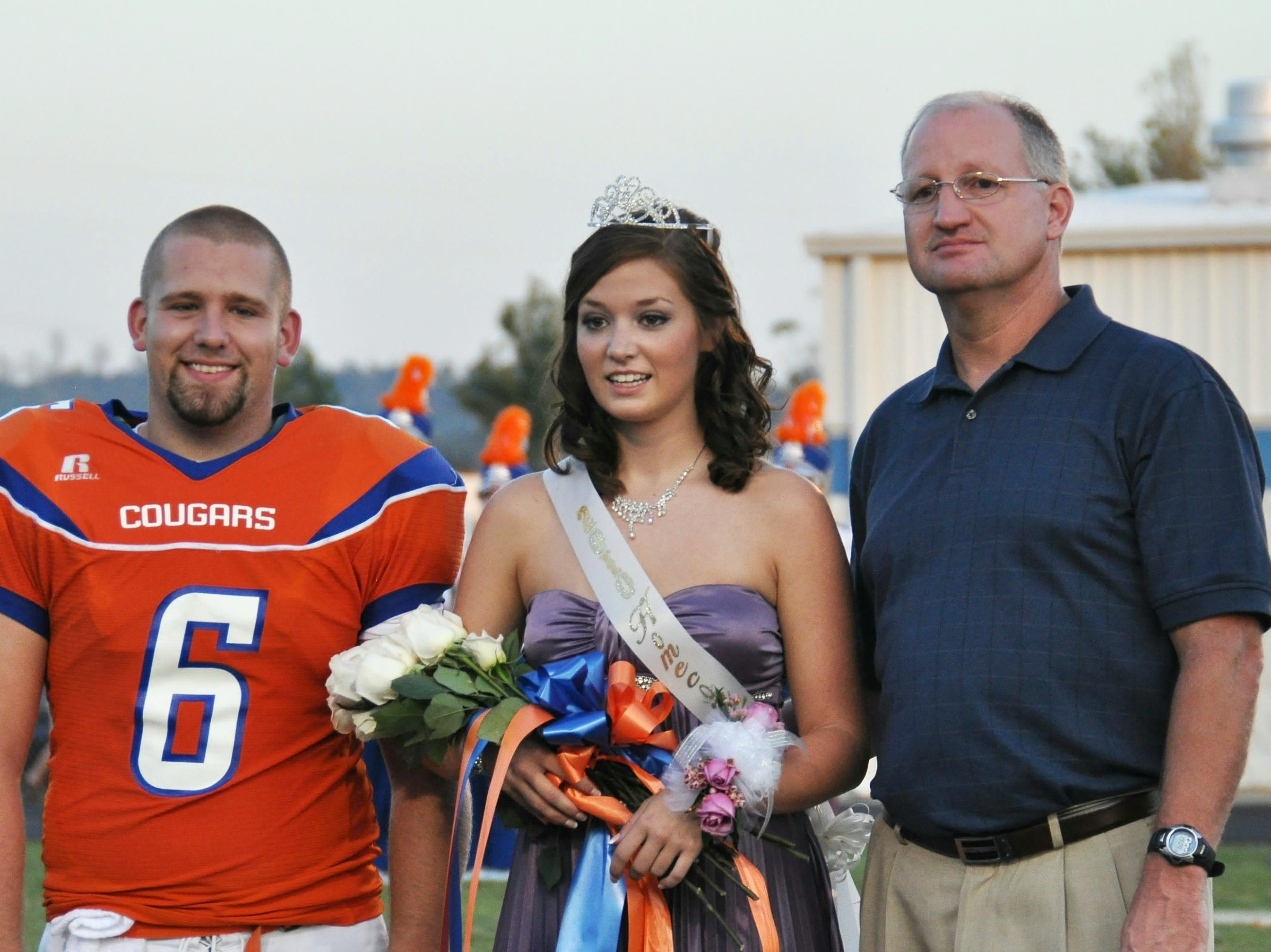 Taylor Bailey, center, is announced as Campbell County High School's Homecoming queen. She is escorted by Garrett Reese, left, and her father, Wendell Bailey.