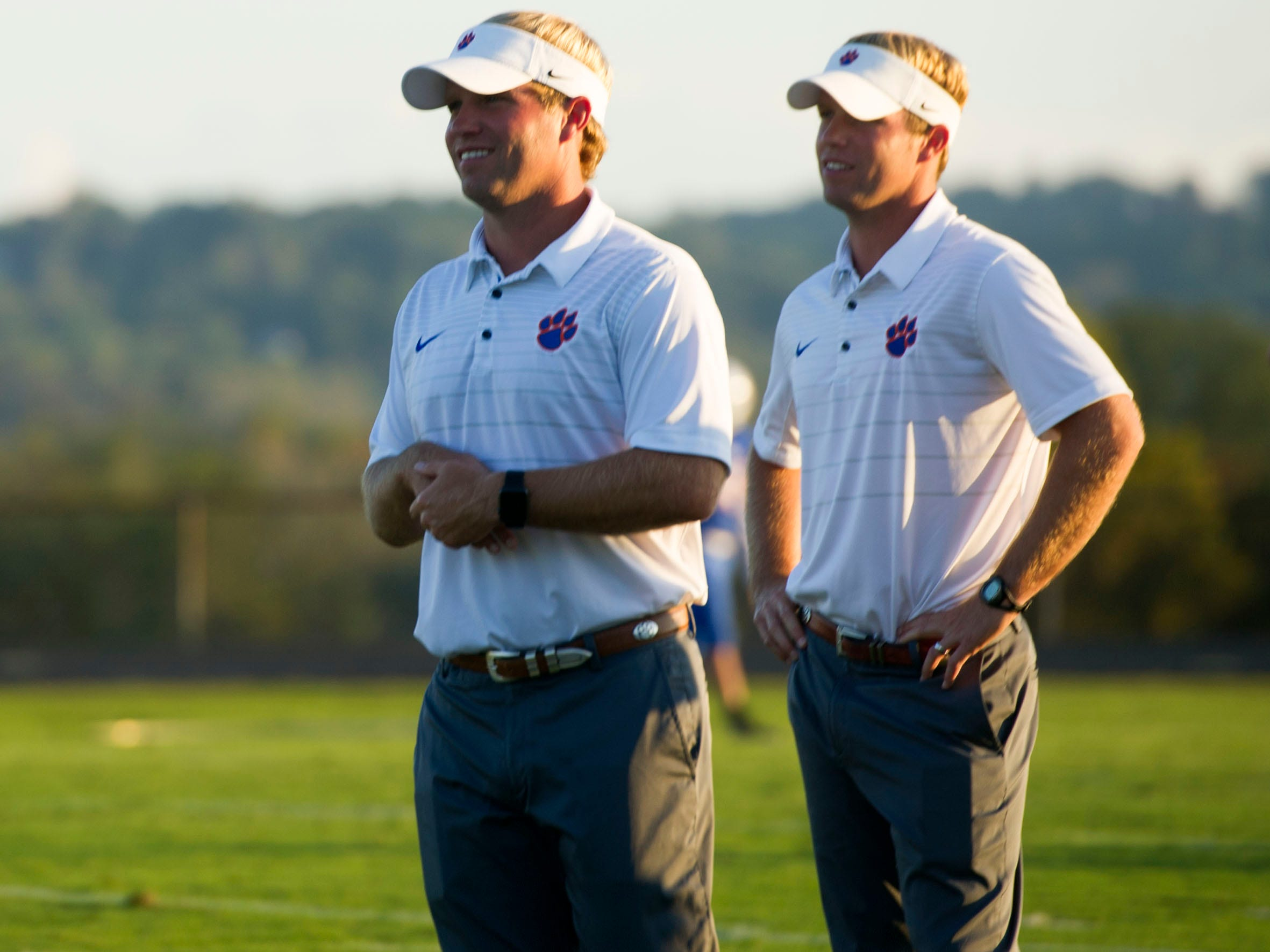Campbell County coaches, brothers, Matt, left, and Justin Price before the start of the game against Fulton at Campbell County on Friday, October 13, 2017.