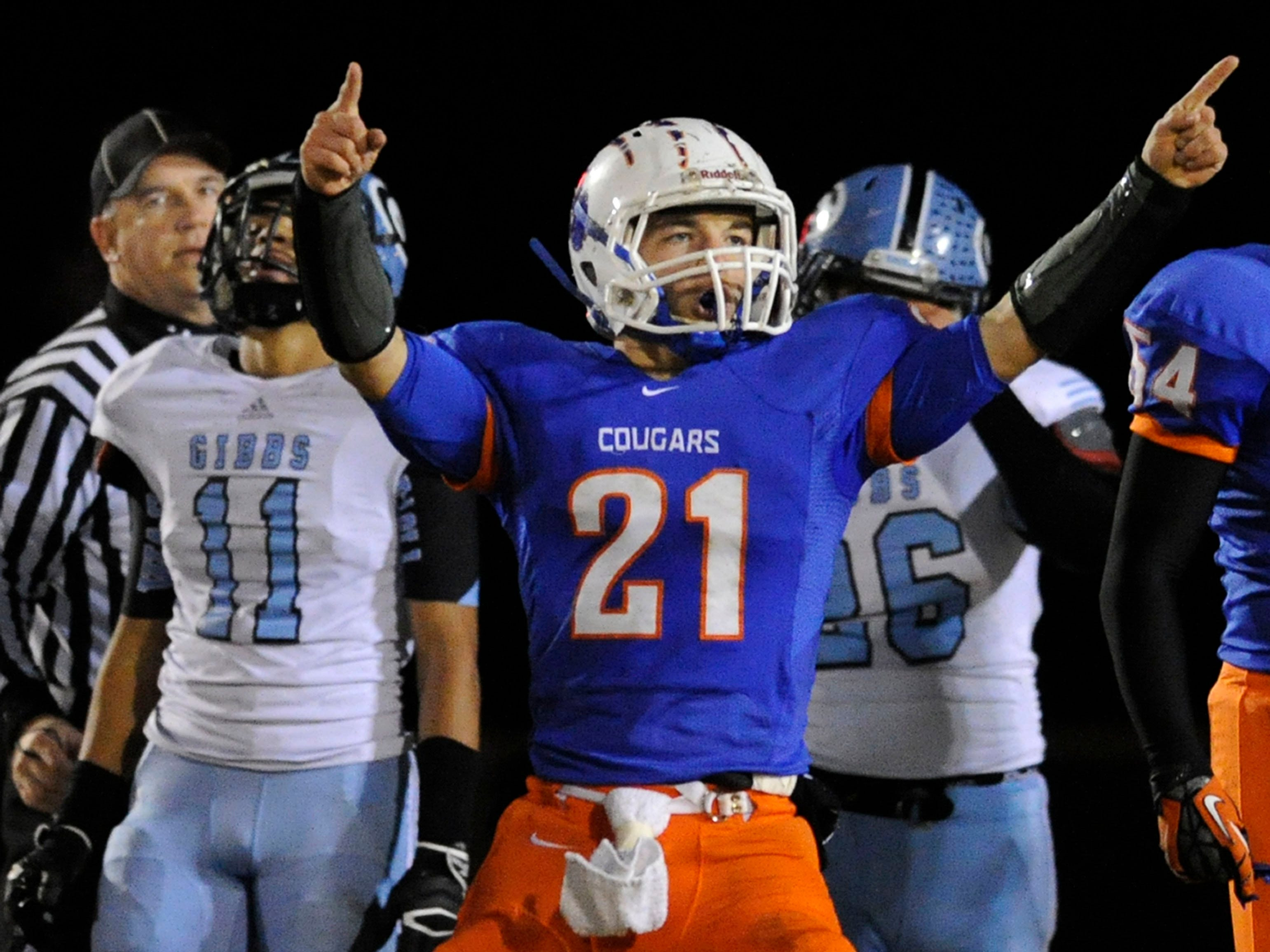 Campbell County's Paul Courdle (21) celebrates a touchdown against Gibbs in the second half at Campbell County High School in Jacksboro on Friday, Nov. 8, 2013.
