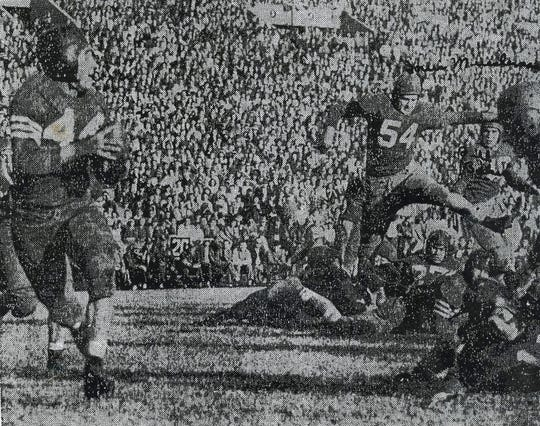 Knoxville and Central boast two of the South's finest high school backs and each was outstanding yesterday as the Bobcats held the Trojans to a 7-all tie. Above Jumping Jack Beeler leaves the ground to make a sizable gain. At bottom Knoxville's W.C. Cooper prepares to get off one of his aerials. Beeler scored Central's only touchdown while Cooper passed for Trojans' tying score.
