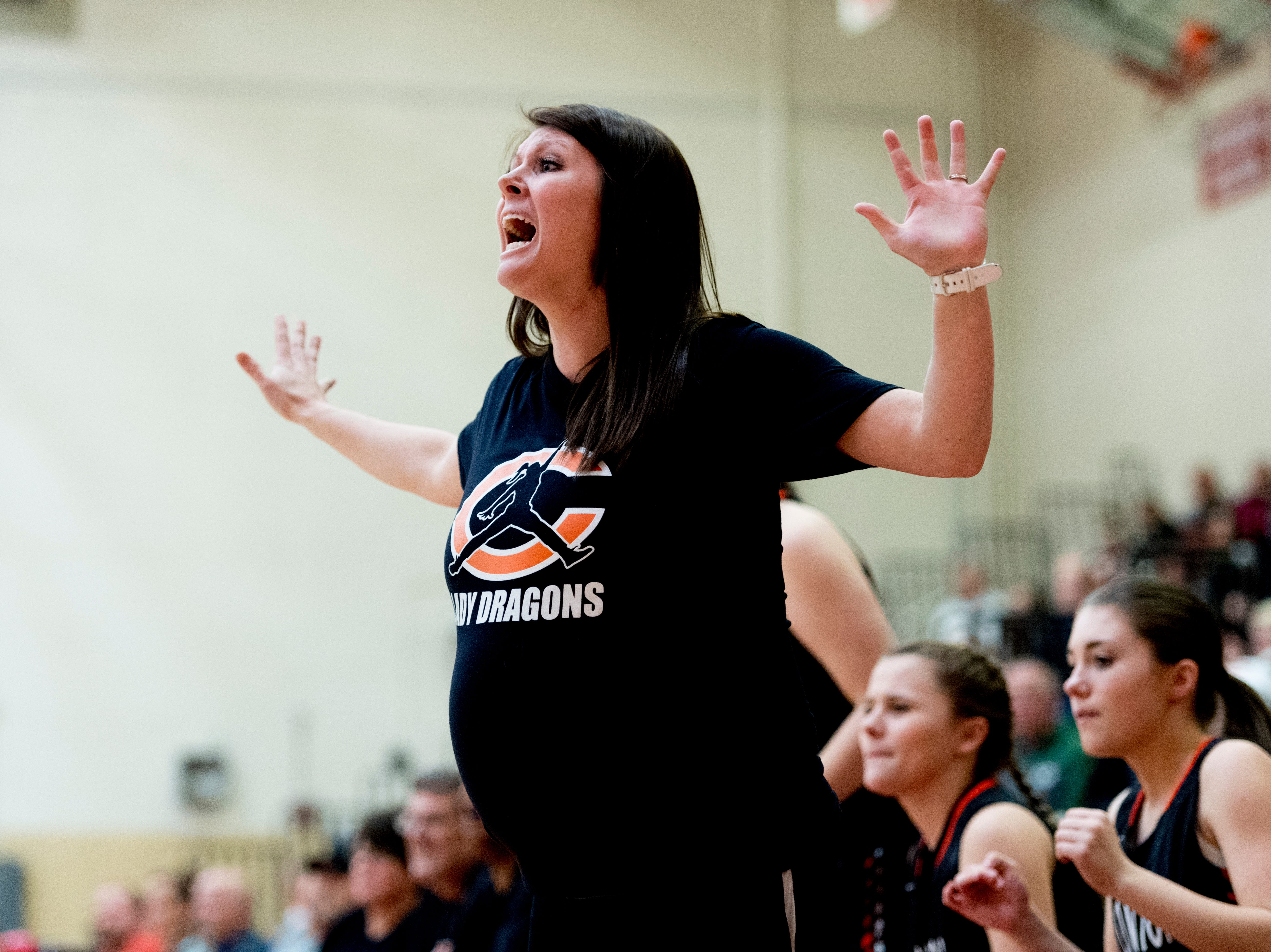 Clinton Head Coach Alicia Phillips calls during a District 3AAA semifinals game between Campbell County and Clinton at Halls High School in Halls, Tennessee on Friday, February 16, 2018.