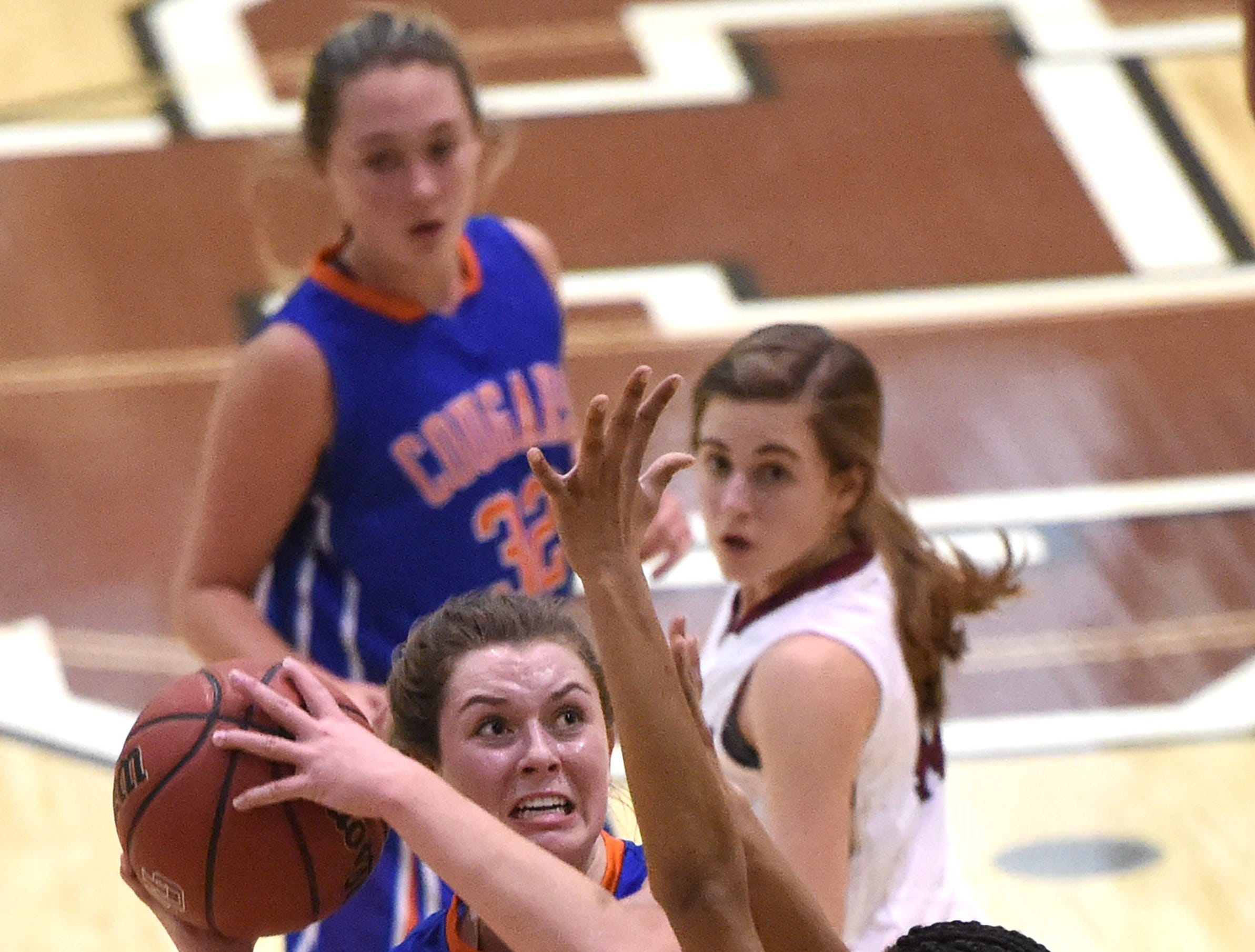 Campbell County's Sarah Cain (10) attempts a shot against Oak Ridge during a high school basketball game at Oak Ridge High School on Tuesday, Jan. 12, 2016.