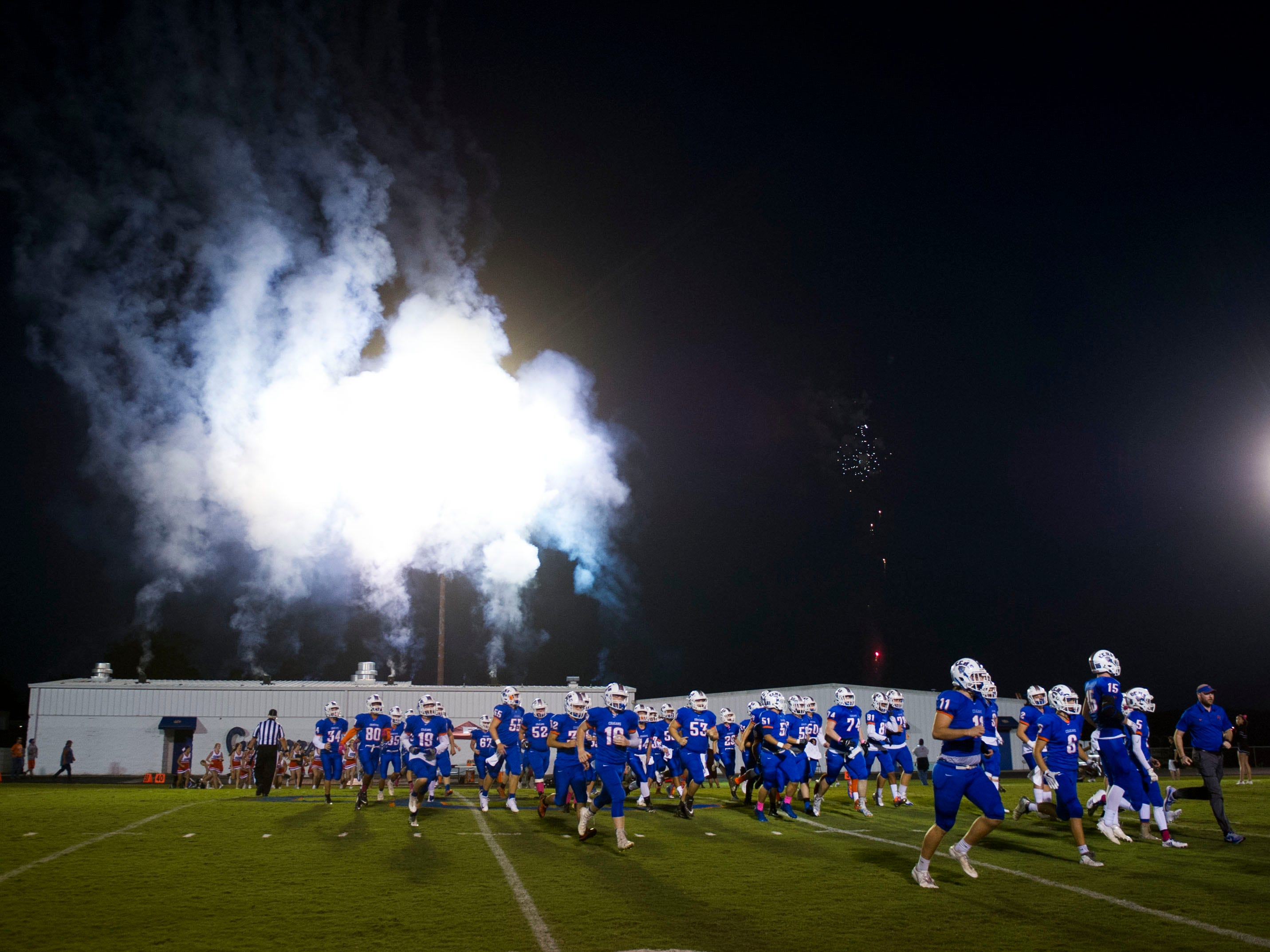 Fireworks erupt overhead as Campbell County takes the field against Fulton on Friday, October 13, 2017.
