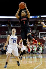 Rogers' Zia Cooke (1) breezes past Gilmour Academy's Annika Corcoran (21) during Ohio's Division II girls basketball state championship matchup in March of 2018 at Value City Arena in Columbus.