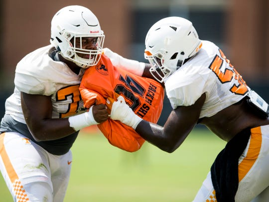 Tennessee offensive linemen Jarious Abercrombie, left, and Jahmir Johnson participate in football practice on the new practice surface at Haslam Field on Tuesday, August 21, 2018.